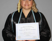 woman blond hair holding a high school diploma