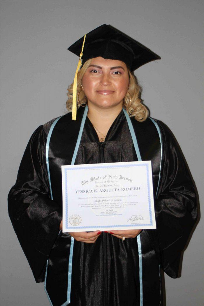 woman blond hair holding a high school diploma